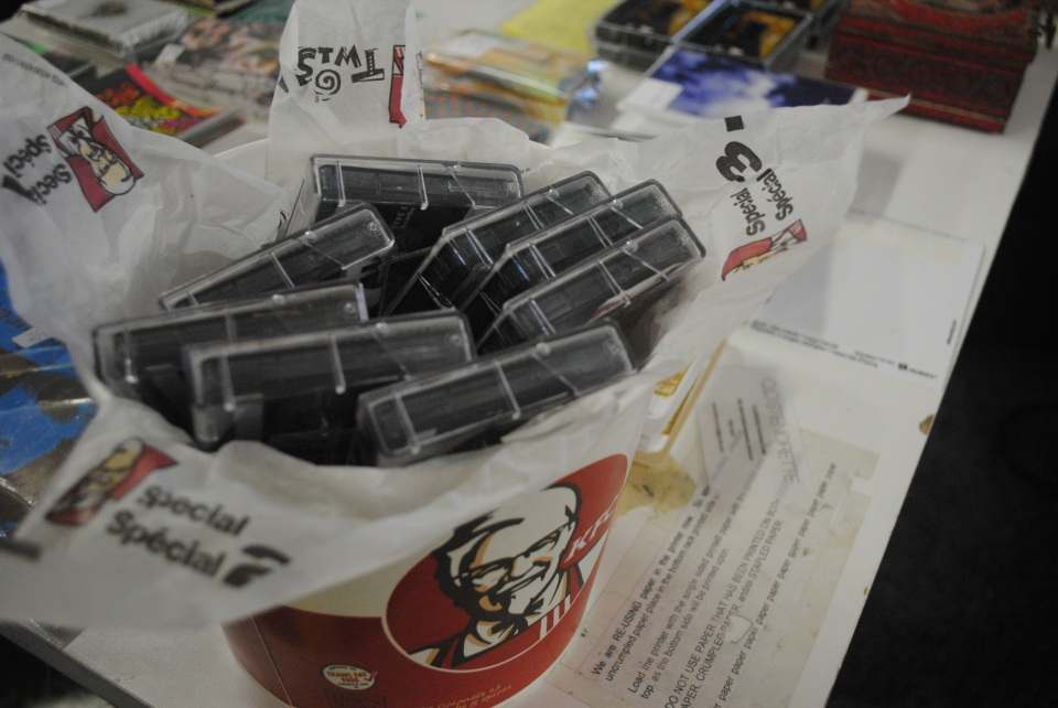 Cassettes overflow a KFC bucket display atop a table for Sonic Boom's Cassette Fair held Sept. 7. The event was held in honour of the first annual international Cassette Store Day, where Weird Canada spoke of plans to feature cassette releases in its upcoming FACTOR grant-funded distribution service. Photo: Tom Beedham