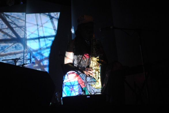 Playing in darkness as projections rolled behind her, Matana Roberts previewed work from the next chapter of her multi-media conceptual project 'COIN COIN' at The Great Hall as part of the Constellation Records showcase. Photo: Tom Beedham